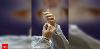 Iran to purchase 60 million Covid-19 vaccines from Russia - Times of India